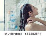 asian women bathing and she was ... | Shutterstock . vector #653883544