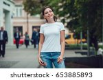 attractive girl in a white t... | Shutterstock . vector #653885893