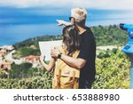 couple hipster tourist hold and ... | Shutterstock . vector #653888980