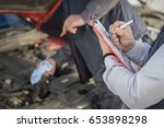 technicians perform vehicle... | Shutterstock . vector #653898298