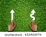 Small photo of Business alignment concept, strategy and planning, hand and arrow on green grass background