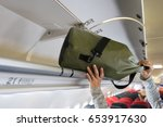 passenger woman putting luggage ... | Shutterstock . vector #653917630