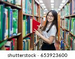 cheerful female asian student... | Shutterstock . vector #653923600