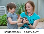young woman with son playing... | Shutterstock . vector #653925694