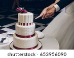 bride and groom cutting wedding ...   Shutterstock . vector #653956090