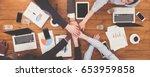 multiethnic team put hands... | Shutterstock . vector #653959858