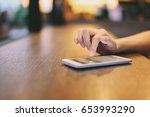 hand of woman using smartphone... | Shutterstock . vector #653993290