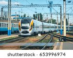 high speed train arrives on the ... | Shutterstock . vector #653996974