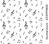 seamless pattern with music... | Shutterstock .eps vector #653999800