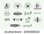 set of vintage surfing logos ... | Shutterstock .eps vector #654008020