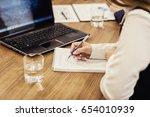 business people partners... | Shutterstock . vector #654010939