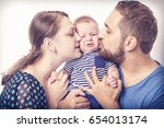 two loving parents kissing... | Shutterstock . vector #654013174