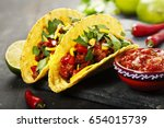 mexican tacos with meat  beans... | Shutterstock . vector #654015739