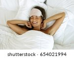 happy woman waking up after... | Shutterstock . vector #654021994