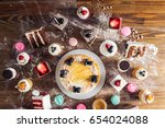 table with loads of cakes ... | Shutterstock . vector #654024088