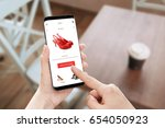 online store app use on modern... | Shutterstock . vector #654050923