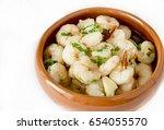 Garlic Prawns Served In A Clay...