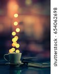 coffee cup and blurred lights... | Shutterstock . vector #654062698