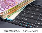euro money with laptop on the... | Shutterstock . vector #654067984