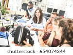 group of young people employee... | Shutterstock . vector #654074344