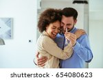 portrait of young couple... | Shutterstock . vector #654080623