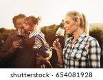 winegrower family tasting wine   Shutterstock . vector #654081928