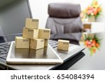small boxes on a white smart... | Shutterstock . vector #654084394