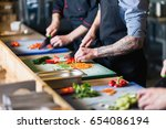 male cooks preparing sushi in... | Shutterstock . vector #654086194