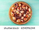 an overhead photo of pulpo a la ... | Shutterstock . vector #654096244