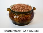 clay pot with dry buckwheat on... | Shutterstock . vector #654137833