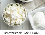 cottage cheese on white wooden... | Shutterstock . vector #654145093