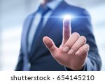 Small photo of Businessman pressing button on virtual screen. Man pointing on futuristic interface. Innovation technology internet and business concept. Space for text and words. Abstract background.