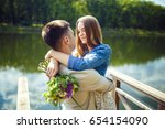 young couple in love outdoor... | Shutterstock . vector #654154090