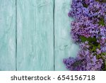 liac on turquoise wooden surface | Shutterstock . vector #654156718