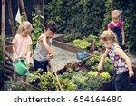 children are in the garden... | Shutterstock . vector #654164680