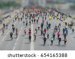 Parade Of Bicyclists In City...