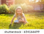happy child girl playing on... | Shutterstock . vector #654166699