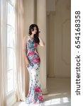beautiful girl wearing long... | Shutterstock . vector #654168358