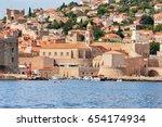 dubrovnik fort and motorboat at ... | Shutterstock . vector #654174934