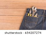 several tools in a denim... | Shutterstock . vector #654207274