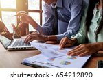 business team analyzing income... | Shutterstock . vector #654212890