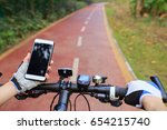 cyclist hands use gps navigator ... | Shutterstock . vector #654215740
