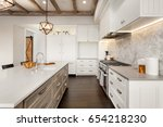 Stock photo kitchen interior with island sink cabinets pendant light fixture and hardwood floors in new 654218230