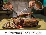 carving of roasted lamb meat | Shutterstock . vector #654221203