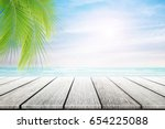 empty wooden table and palm... | Shutterstock . vector #654225088