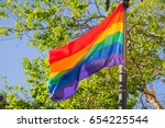 rainbow flag blowing in the... | Shutterstock . vector #654225544