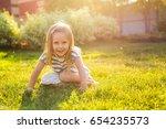 sweet little girl play outdoors | Shutterstock . vector #654235573