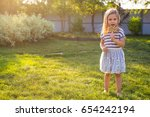 funny child with candy lollipop ... | Shutterstock . vector #654242194