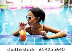 asian woman drinking juice by...