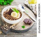 chocolate oatmeal for breakfast ... | Shutterstock . vector #654268804